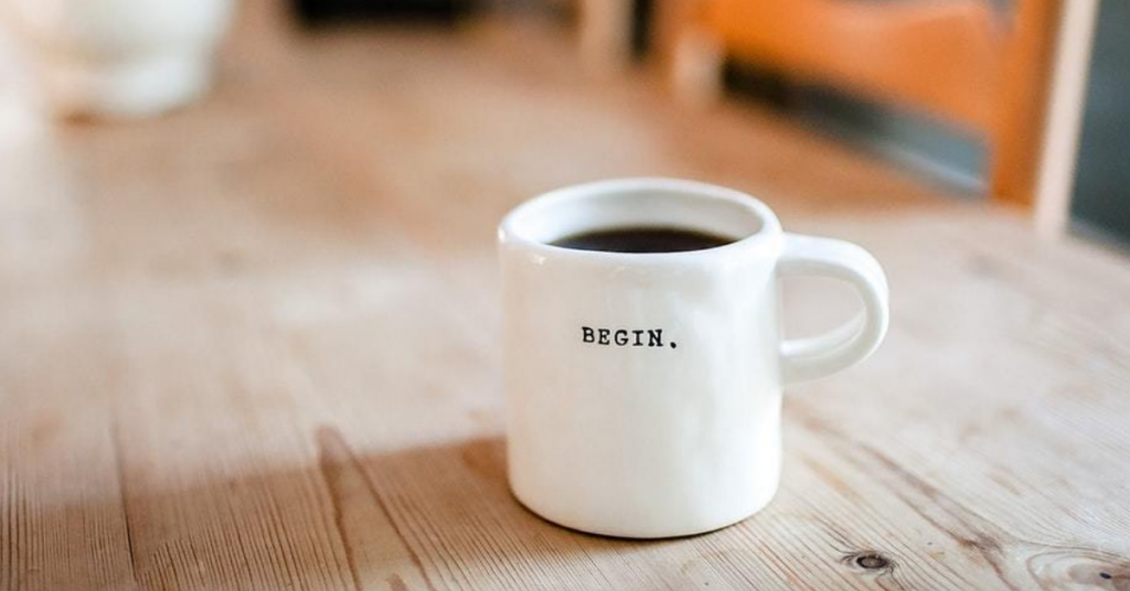 Coffee cup with the word Begin